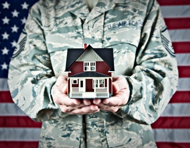 Service member holding home